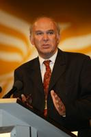 Vince Cable MP on conference podium
