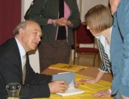 Vince Cable signing his book - The Storm